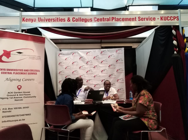KUCCPS staff attending to clients at the Nairobi International Education and Career Fair on January 18, 2019.